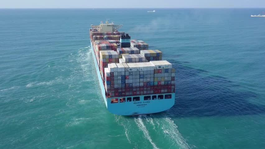 Mediterranean sea - January 5, 2019: Maersk Evora ultra large container vessel (ULCV - 366 Meters) loaded with various container brands at The Mediterranean Sea - Aerial footage. #1021961530