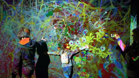 "HELSINKI, FINLAND - JAN 06, 2019: ""Massless"" Exhibition - immersive interactive graphic digital installations by a group of Japanese artists TeamLab at the Amos Rex Museum. Children and adults enjoy"