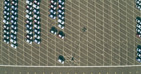 Aerial view of giant parking lot filled with cars in New York during the day time under overcast sky. Wide shot on 4K RED camera.