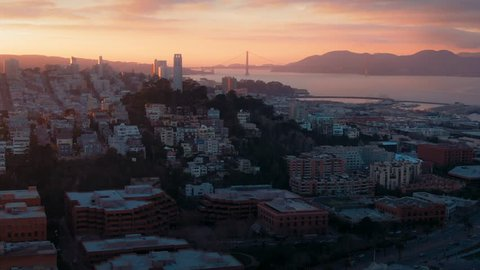 Aerial Drone Of The San Francisco City Skyline and coit tower at Sunset