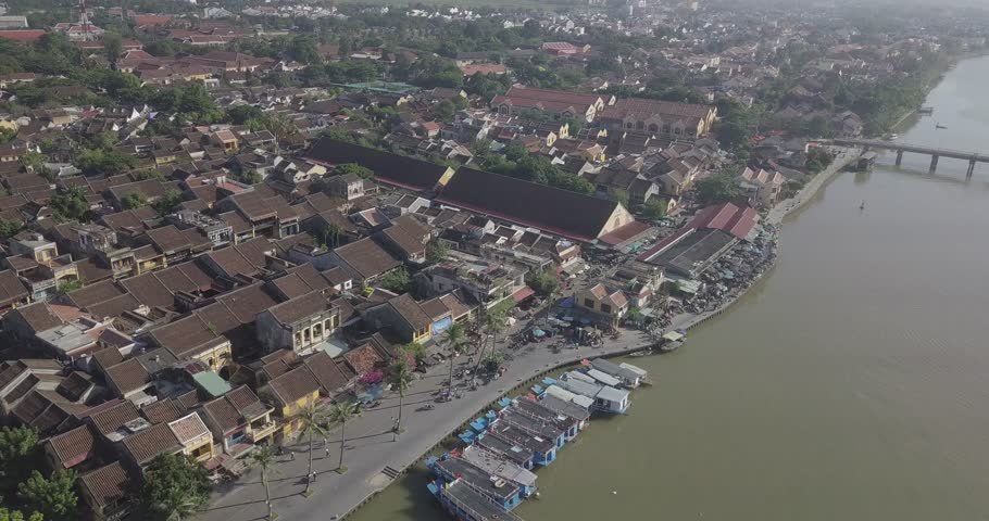 Aerial view panoramic of Hoi An old town or Hoian ancient town. Royalty high-quality free stock video footage top view house, rooftop, river of Hoi An city. Hoian city is the most popular destination | Shutterstock HD Video #1022187910