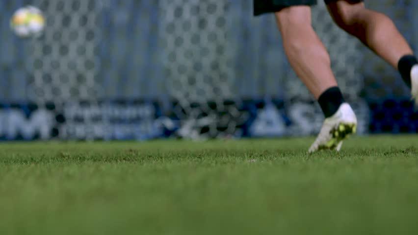 Soccer player training drills on an empty stadium football field | Shutterstock HD Video #1022200510