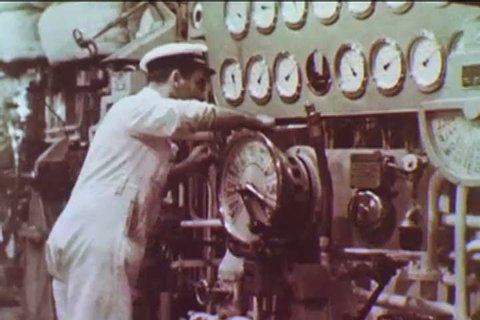 CIRCA 1955 - Men are shown at work inside the wheelhouse and engine room of the TSS Olympia.