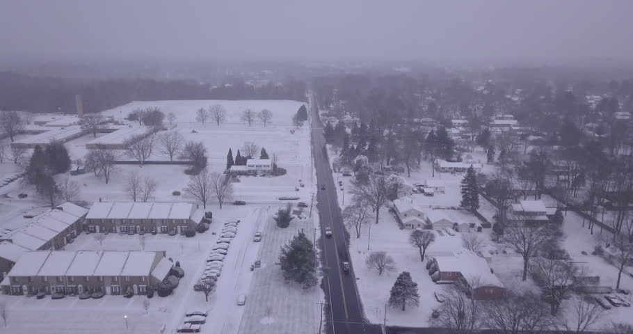 Drone following over snowy town and road straight #1022330560