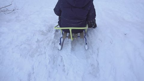 Child sledding on a sled