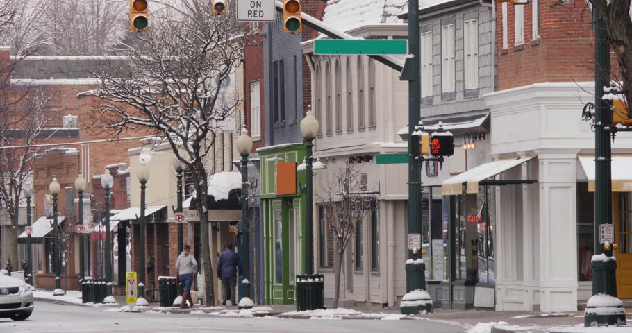 A long shot of a small American town's business district in the winter season. Pittsburgh suburbs. Non-snowing version.  | Shutterstock HD Video #1022422960