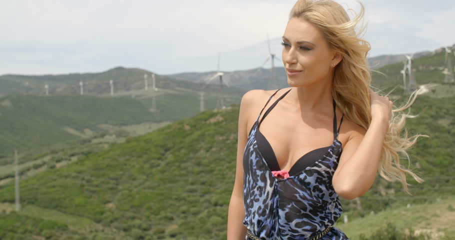 Image of: Crush Attractive Blond Woman Wearing Bikini And Animal Print Dress And Hair Blowing In Breeze Standing On Hill Near Wind Farm Shutterstock Attractive Blond Woman Wearing Bikini Stock Footage Video 100