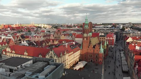 Aerial view of Wroclaw city hall. Beautiful, old town. Crowdy main street of a big, Polish city.