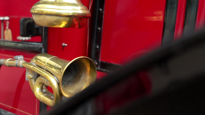 Close up shot of a brass horn and a vintage lantern on an oldtimer bus coach.
