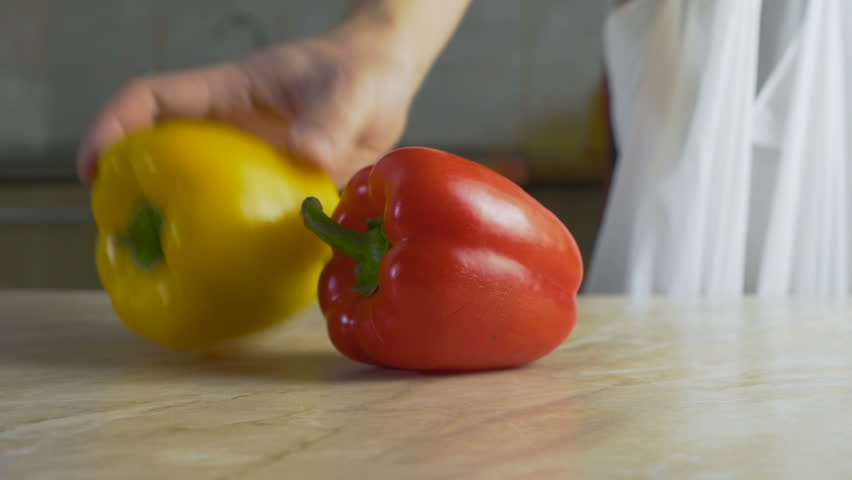 Man puts natural farm vegetables on the table at home kitchen in slow motion | Shutterstock HD Video #1022561740