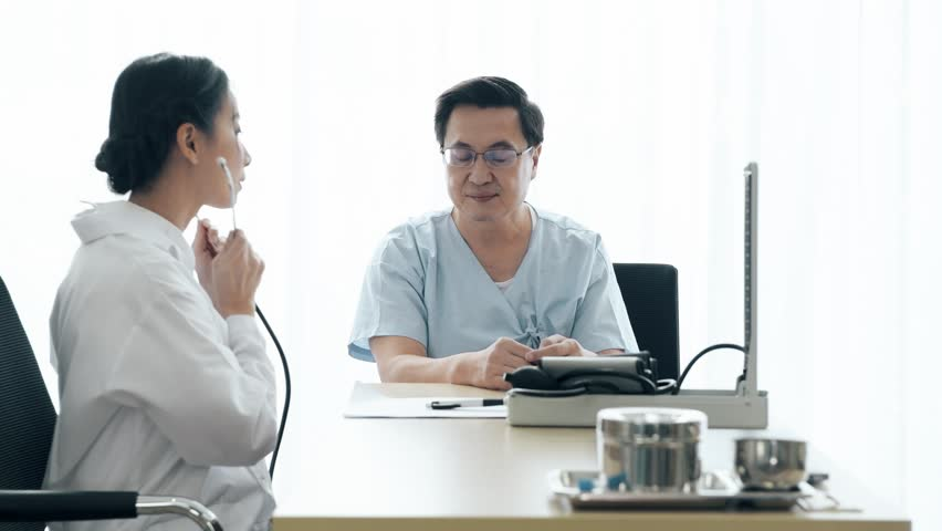Doctor with patient. Young female medical doctor talking to a senior patient at hospital, measuring heart rate. Senior care medical and insurance concept. | Shutterstock HD Video #1022583430