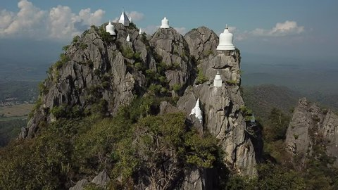Lampang / Thailand - January 10th  2019:  Aerial view of Wat Chalermprakiat Prajomklao Rachanusorn. Stupa on top of mountain at Lampang, North of Thailand