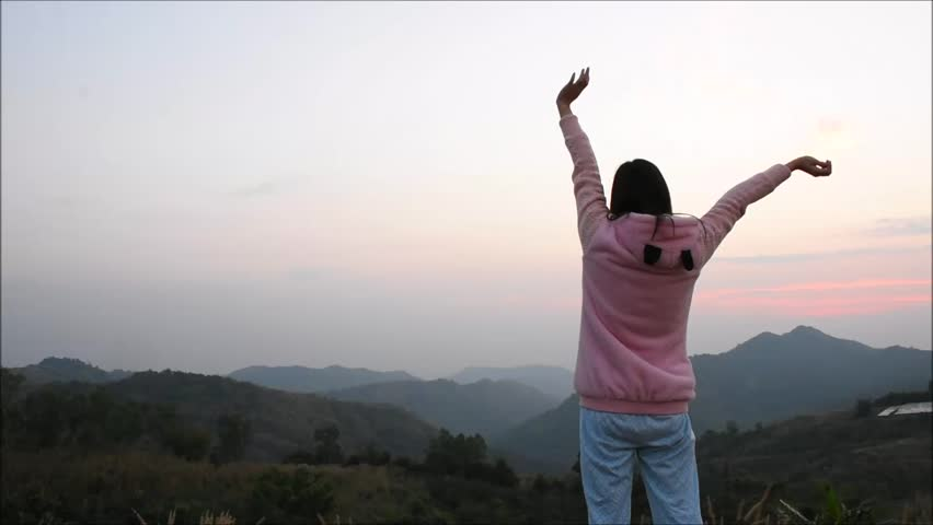 Young girl are relax with landscape view of green mountain in the morning, Back side of girl are exercise on the peak of mountain with mountain view and sunrise sky, Landscape nature in Thailand #1022605810