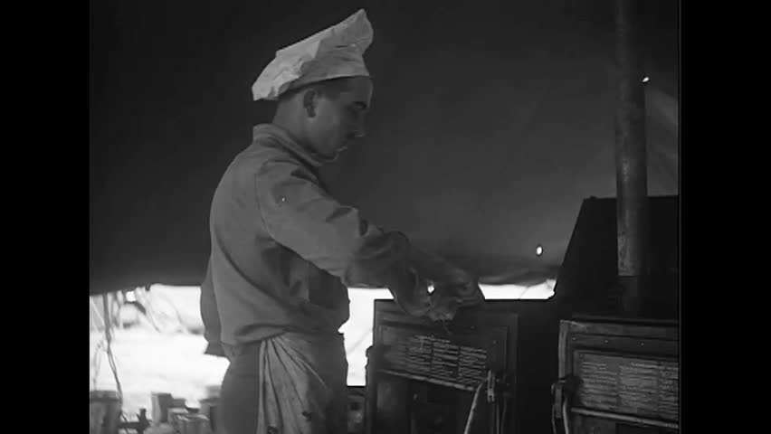 CIRCA 1940s - French Chef cooking for the French Air Force during World War II | Shutterstock HD Video #1022607190