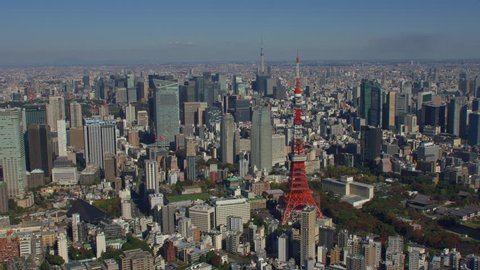 Tokyo, Japan circa-2018. Aerial view of Tokyo Tower and city of Tokyo. Shot from helicopter with RED camera.