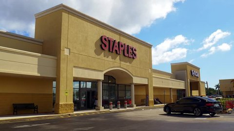 Pompano Beach, Florida, USA - January 06, 2019 : Staples Office Superstore entrance in Pompano Beach, Florida. The office supply store chain has more than 2,200 stores worldwide.