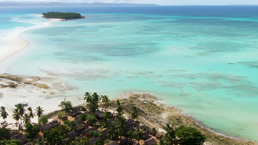 Aerial orbit and dolly of incredible Nosy Iranja island spit off a short cruise from Nosy Be, Madagascar | Shutterstock HD Video #1022643520