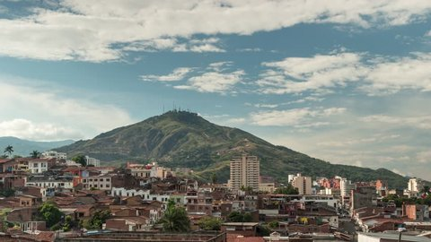 """Timelapse of Santiago de Cali, San Antonio district, Valle del Cauca, Colombia. The salsa capital is dominated by the """"Cerro de las Tres Cruces"""" (three cross hill), on a sunny day."""