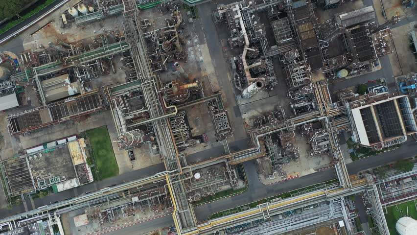 Aerial top down view over oil refinery or chemical factory and power plant with many storage tanks and pipelines. Shot with 4K UHD resolution drone. | Shutterstock HD Video #1022650810