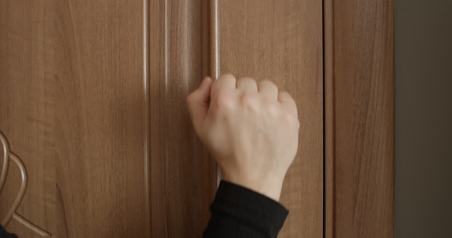 Knocking Door with Male and Female Hand Close Up Banging on the Wooden Brown Door | Shutterstock HD Video #1022663320