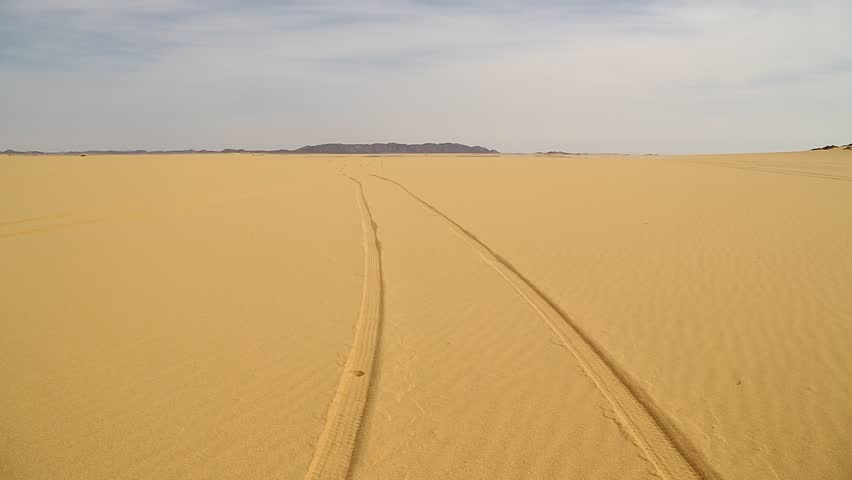 In the middle of the desert rock and track like concept of wild and nature scenic land   | Shutterstock HD Video #1022760610