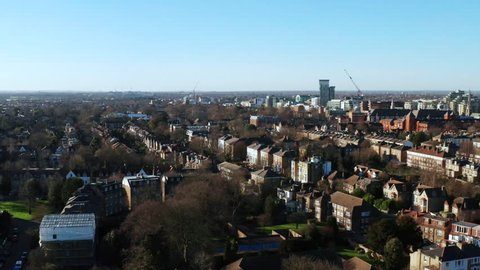 Aerial footage of a European city in the sunshine