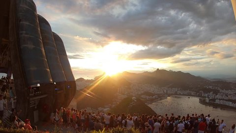 Brazil, Rio de Janeiro: January 7, 2019: Rio de Janeiro at sunset. Incredible view of the city and mountains from Sugar Loaf. Timelapse. 4k