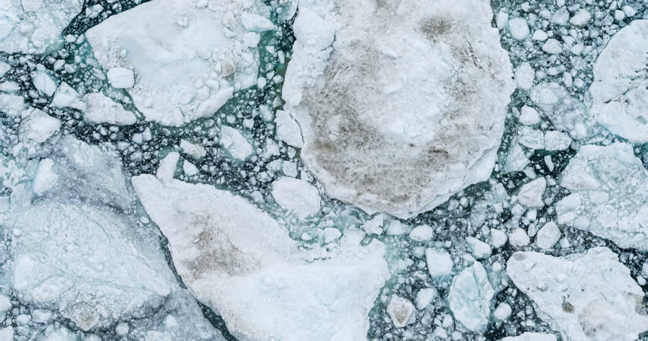 Icebergs drone aerial video top view - Climate Change and Global Warming - Icebergs from melting glacier in icefjord in Ilulissat, Greenland. Arctic nature ice landscape in Unesco World Heritage Site.
