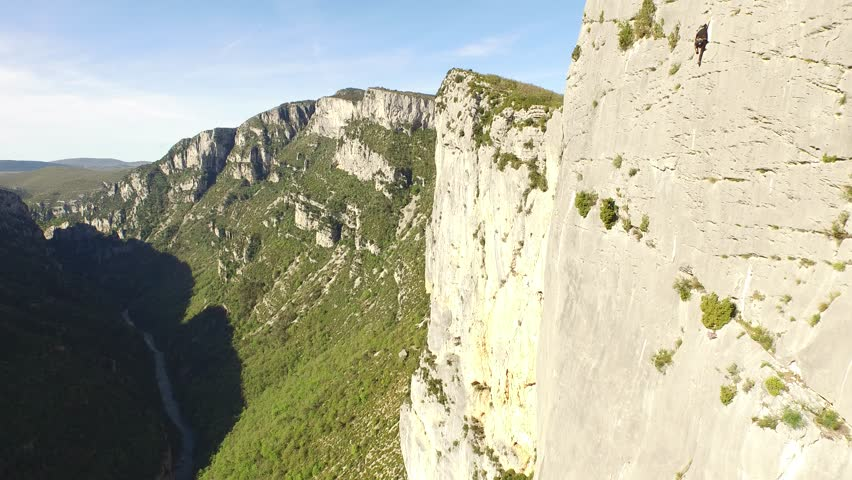 Aerial view by drone of a man climbing in free solo, without safety material, a very high cliff in Verdon, France | Shutterstock HD Video #1022819530