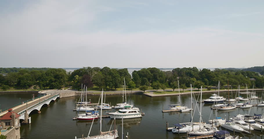 Rising Aerial Pan of Docked Boats in New Rochelle New York | Shutterstock HD Video #1022833030