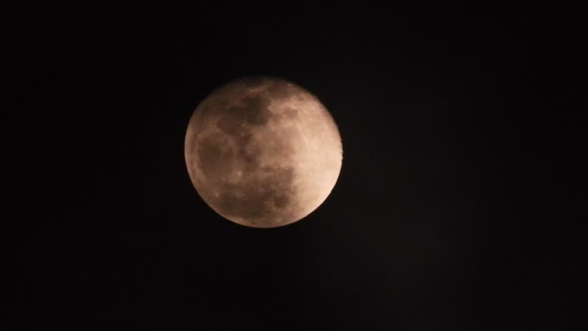 Extreme zoom photo of moon at night with deep dark clouds and strong wind | Shutterstock HD Video #1022837560