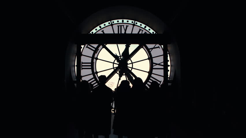 Silhouettes of people group of tourists near the big clock in the d'Orsay museum of Paris, France | Shutterstock HD Video #1022838970