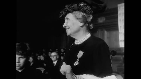 CIRCA 1950s - Author and political activist Helen Adams Keller receives a medal and a bouquet of flowers after lecturing at an assembly.