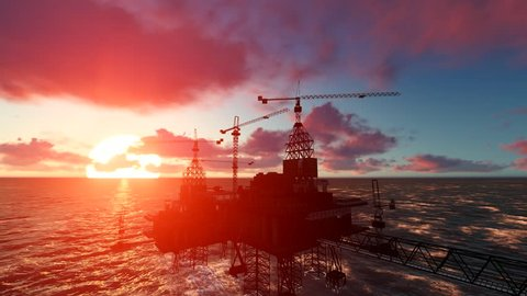 Offshore oil and rig platform in sunset time. Construction of production process in the sea. Power energy of the world. Oil Rig in Ocean at sunset