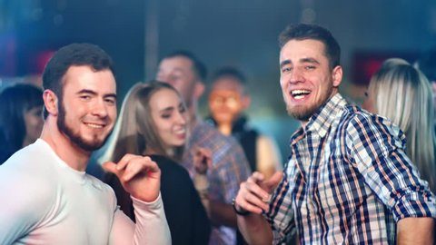 Gay couple is dancing at a party
