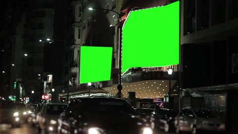 "Corrientes Avenue with Billboards Green Screen, in Buenos Aires (Argentina).  You can replace green screen with the footage or picture you want with ""Keying"" effect (check out tutorials)."