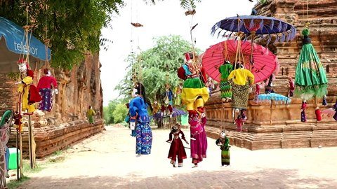 BAGAN, MYANMAR, MAY 17 2018,  Traditional Myanmar puppets hangs on rope on tree in area Buddhist temple.