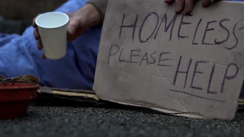 Homeless Man Sat Begging With Sign 'Please Help' On Road, 4K.