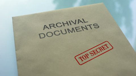 Archival documents top secret, stamping seal on folder with important documents