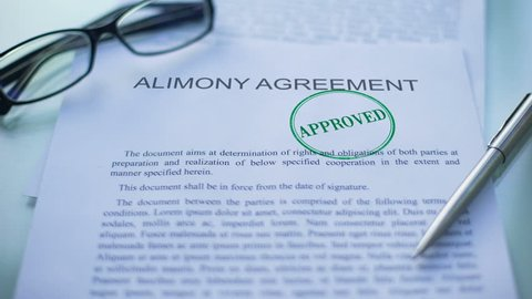 Alimony agreement approved, officials hand stamping seal on business document