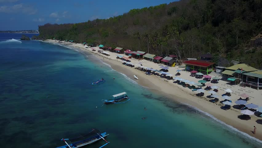 4K Drone Footage Aerial of Thomas Beach in Uluwatu Bali with Crystal Clear Water   Shutterstock HD Video #1023102070