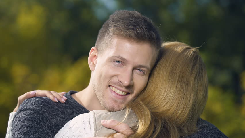 Male Embracing Female and Looking Stock Footage Video (100% Royalty-free)  1023107920 | Shutterstock