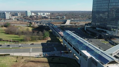 Tysons, VA / USA - December 29 2018: Descending shot showing the Metro Silver Line leading into Tysons Corner station with the Beltway in the background