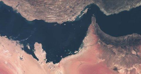 Persian Gulf aerial seen from satellite high altitude at space. Dubai, Abu Dhabi, Qatar, Saudi-Arabia, Oman and Iran. Sea, coastline and desert. Contains modified Copernicus Sentinel data (2018).