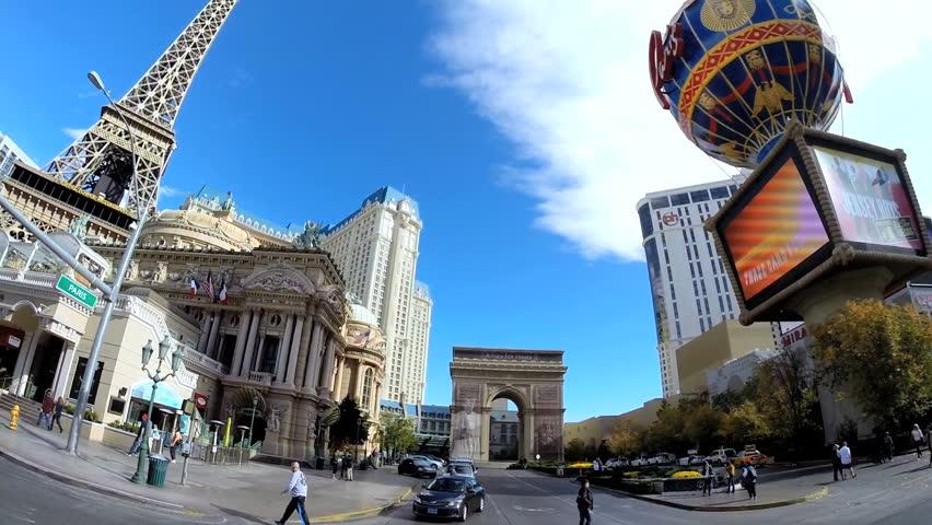 Las Vegas, USA - January 2014: POV wide angle driving Casinos modern building Architecture illuminated neon signs Nevada USA