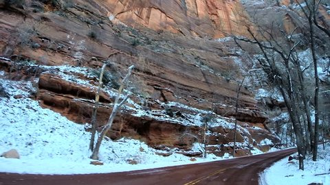 POV vehicle road drive sandstone rock cliffs extreme terrain Zion National Park Utah Southwestern United States