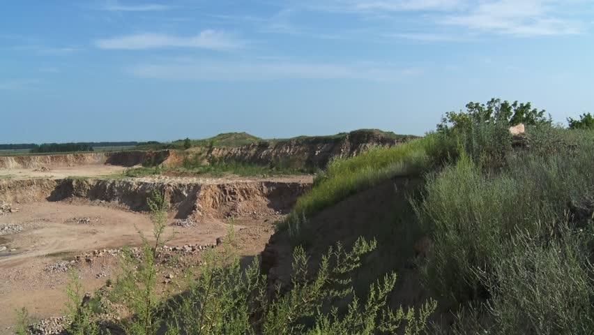 Quarry excavator loads stones into a big dump truck   Shutterstock HD Video #1023255400