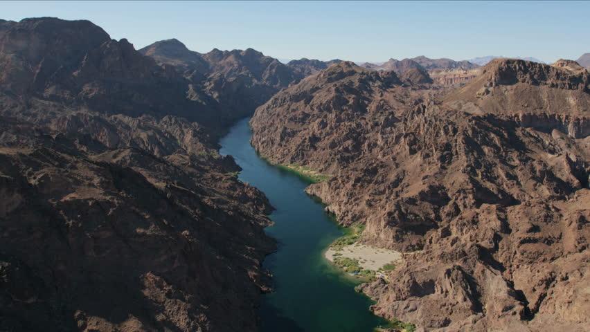 Aerial Landscape view of Colorado River arid rocky Mountain Range Mojave desert a remote Extreme Terrain Wilderness area Las Vegas Nevada USA  | Shutterstock HD Video #1023284320