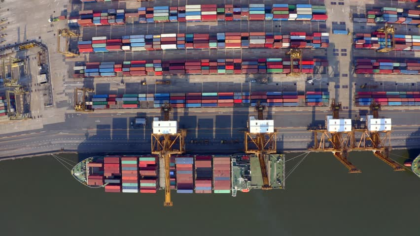 Aerial shot of pier in port of Bangkok, Thailand.Top view of container ship in export and import business and logistics. Shipping cargo to harbor by crane. International water transport concept. | Shutterstock HD Video #1023355060