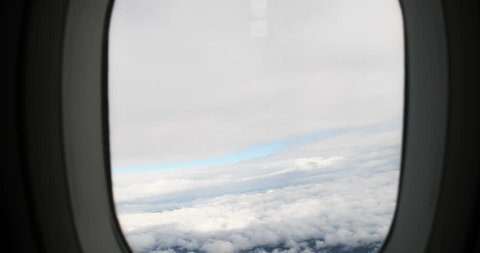 Beautiful view from plane window seat. White clouds and sky. Aerial photo of airplane. Nobody. Shot from above. Glorious sight. Day, travel.